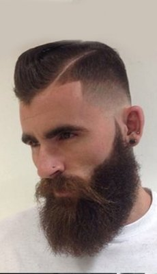 shaved-sides-long-top-bearded-trendy-hairstyle